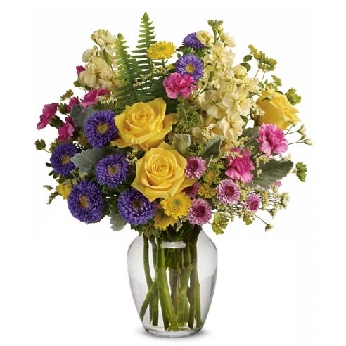 spring flower bouquet in a clear glass vase for same day flower delivery online