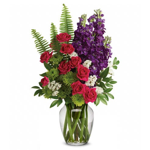 Modern flower bouquet with pink roses, cheap flowers, and purple stock in a vase