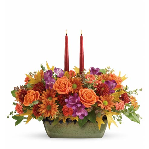 Orange rose fall candle flower centerpiece with orange roses and two candles