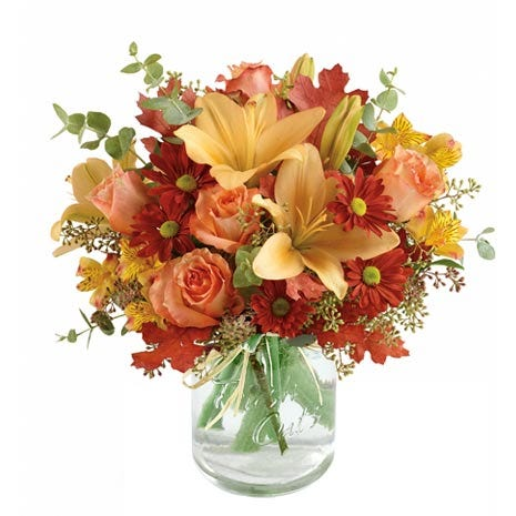 Orange mason jar flowers arrangement with peach lilies, peach roses and vase