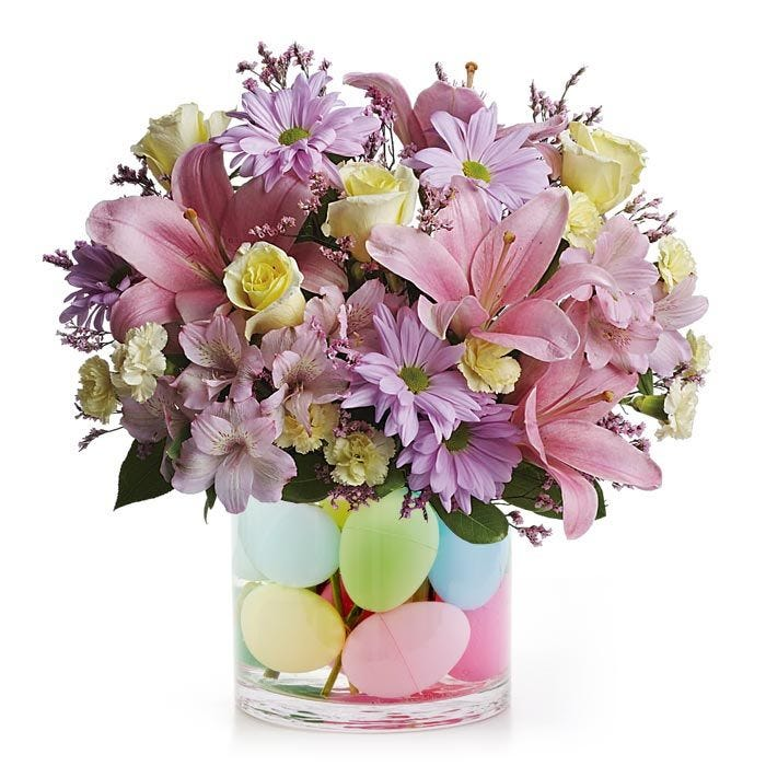 Pink lily and lavender daisy mixed Easter flowers bouquet with plastic Easter eggs