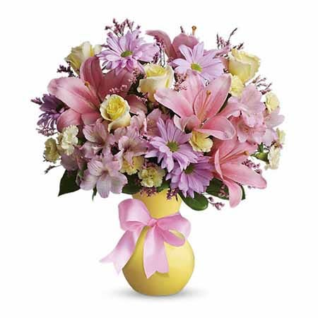 Mixed pastel flowers bouquet with pink lilies, yellow roses and lavender daisies