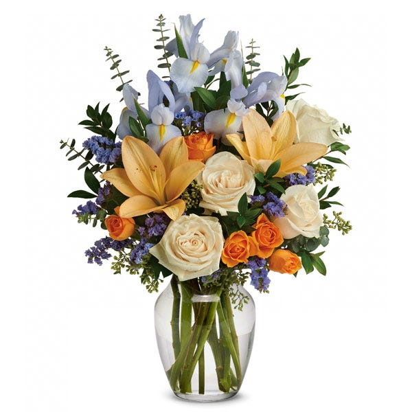 Spring bouquet of cream roses, light blue iris, peach lilies and orange spray roses
