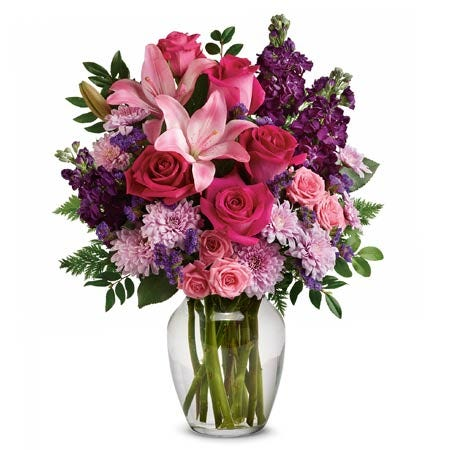 Romantic spring mixed flower bouquet with hot pink roses, lily and purple stock