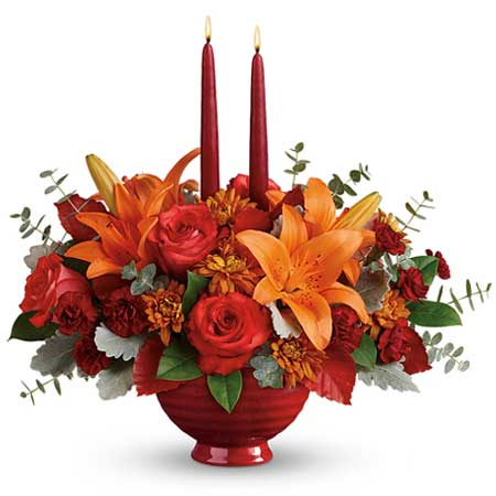 Fall flower candle centerpiece with dark orange rose, orange tiger lily and candles