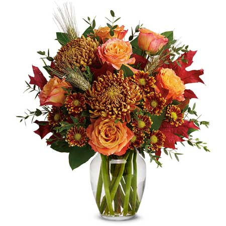 Rust chrysanthemum flower bouquet with fall flowers and orange roses