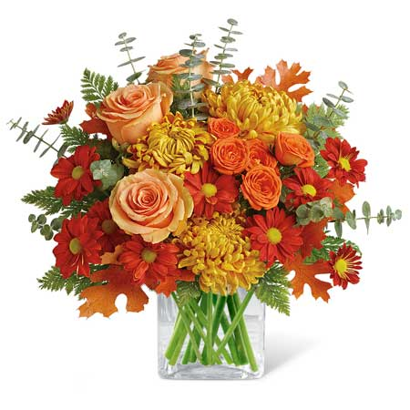 Fall orange flower bouquet with pale orange roses and orange chrysanthemums