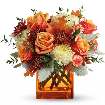 Fall flower bouquet with orange roses, red chrysanthemums, and yellow oak leaves