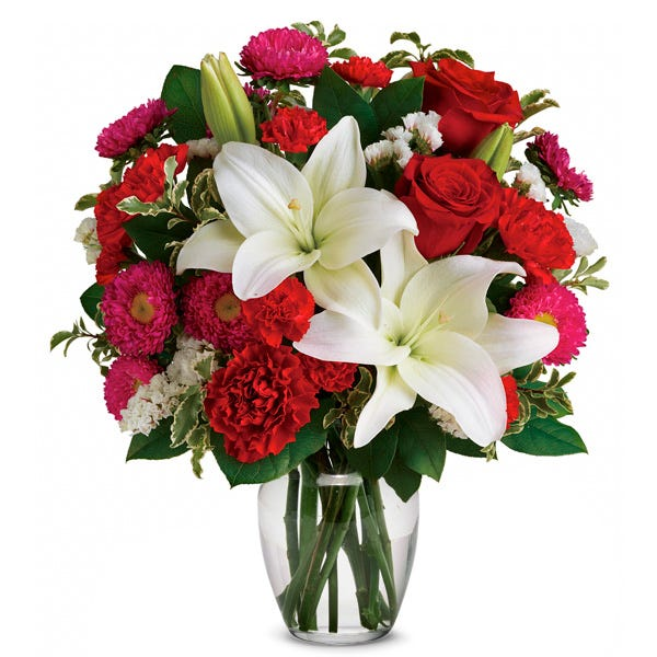 White lily, red roses, red carnations and hot pink Matsumoto asters bouquet