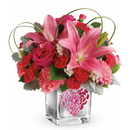Pink lilies, red roses and carnations in a square heart vase