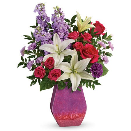 White lily, pink rose, lavender stock and purple carnations glitter vase bouquet