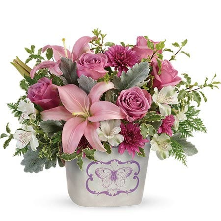Pink lily lavender roses bouquet in a butterfly print keepsake vase