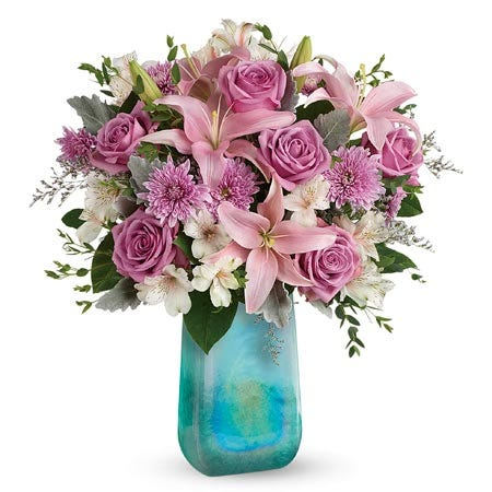 Pink asiatic lily, purple roses and lavender chrysanthemums bouquet in blue vase