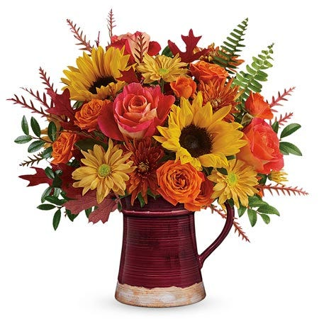 Orange rose and sunflower mug arrangement with brown daisies and brown mums
