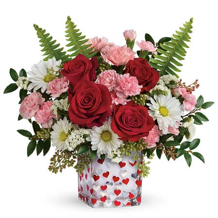 Valentines Day flower delivery with pink carnations, red roses and heart vase