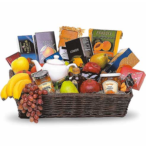 Luxury tea gifts basket with teas, fruits, jam, chocolate, crackers and cookies
