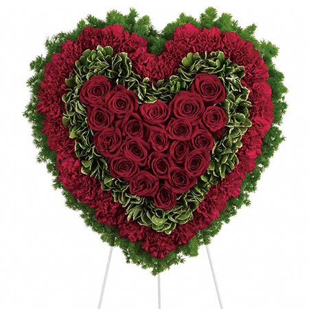 Red roses and red carnations heart shaped funeral standing spray