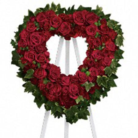 Red roses and red carnations open heart funeral flowers standing spray