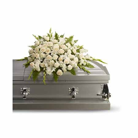 Funeral coffin sprays at send flowers like this white standing spray