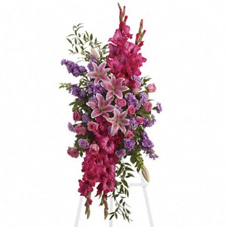 Pink oriental lily and pink rose oval funeral flowers standing spray with easel