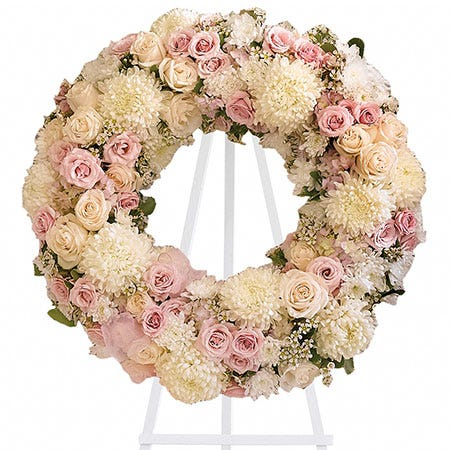 Pink rose and white chrysanthemum open center ring funeral standing spray wreath