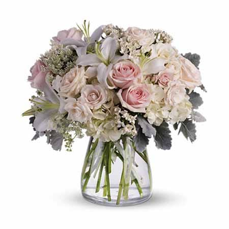 white wedding flower bouquet with pale pink rose, white roses and white hydrangea