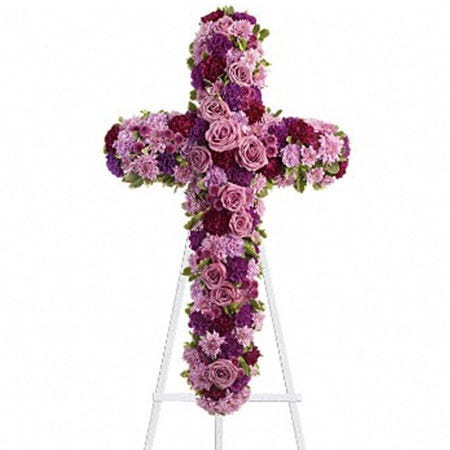 Lavender rose cross shaped funeral flowers standing spray with easel stand
