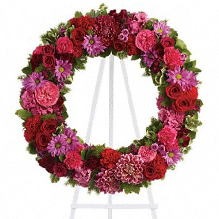 Pink flower funeral ring wreath flower standing spray with easel and dahlias