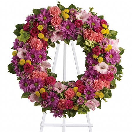 Summer flowers ring wreath funeral flowers standing spray with pink gladioli