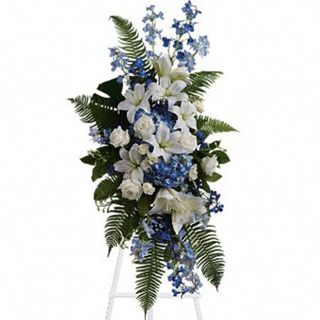 White and blue funeral flowers standing spray with blue delphinium and white lily