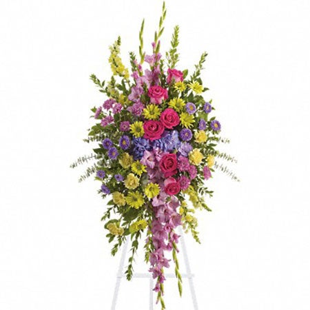Cheap standing spray with roses, carnations, and snapdragons for flower delivery