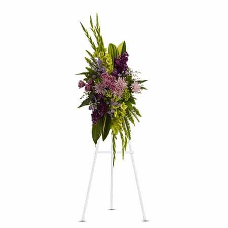 Oval shaped green cymbidium orchid and fuji mums funeral flower standing spray