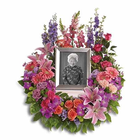 Picture frame funeral flowers arrangement bouquet with pastel flowers
