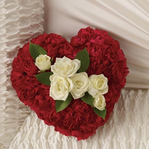 Heart funeral flowers made with white sympathy roses and white flowers for funerals