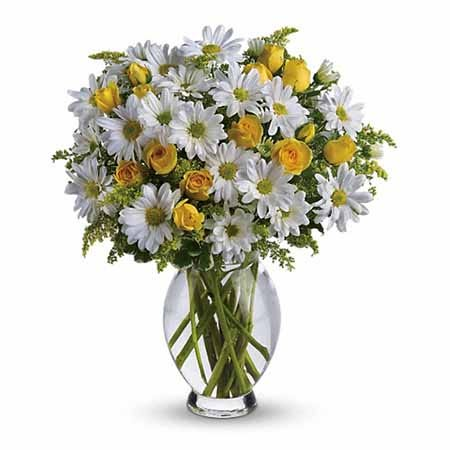 White daisy and miniature yellow roses bouquet in glass vase of spring flowers