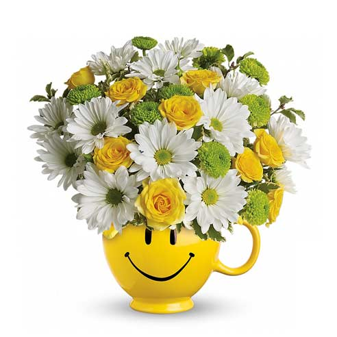 White daisy bouquet delivery from send flowers inside smiley face coffee cup