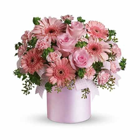Pale Light pink gerbera daisy and rose bouquet inside a pale pink vase