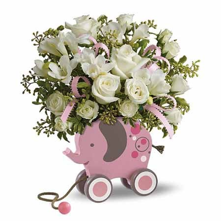 Easter gift ideas Easter baskets for babies pink elephant toy with baby flowers