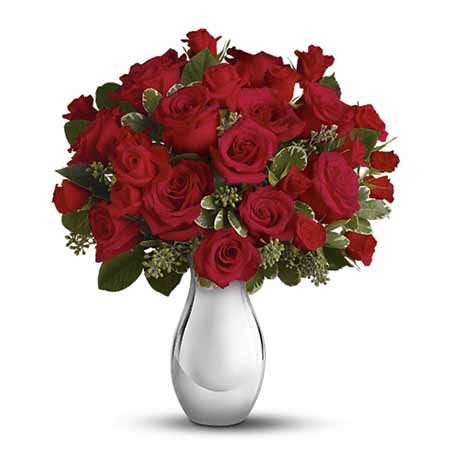 Red and silver flower bouquet with red roses, red spray roses and silver vase