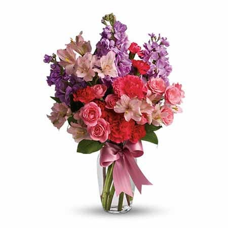 Mixed spring pastel flowers bouquet with pink roses and carnations and lavender stock