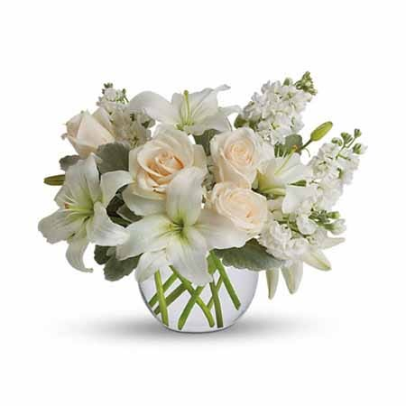 White asiatic lily and cream roses bouquet with white stock flowers and bubble vase