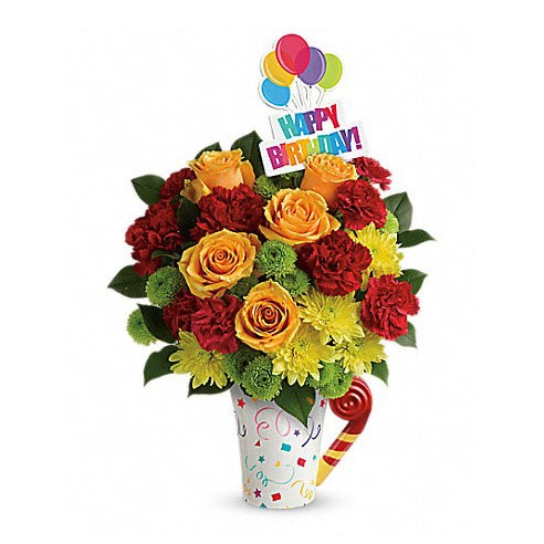 Birthday flowers for a man with orange roses and red carnations in a coffee cup