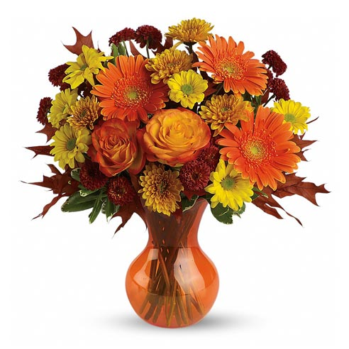Orange flowers and orange roses featured in this orange flower bouquet