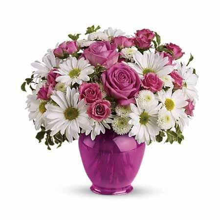 Pink rose and white daisy chrysanthemum bouquet with ginger jar