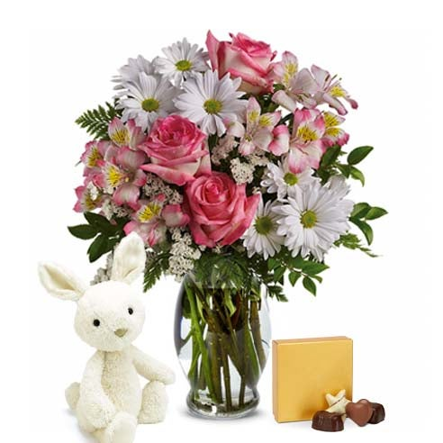Easter presents for kids with Easter flowers, easter chocolate, and stuffed animal delivery