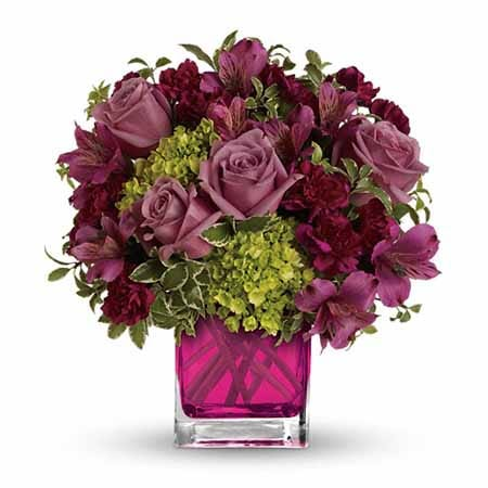 dark purple flowers with purple roses in purple glass vase
