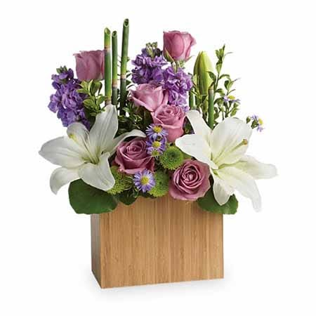 Lavender roses zen flower arrangement in wooden flower vase with card