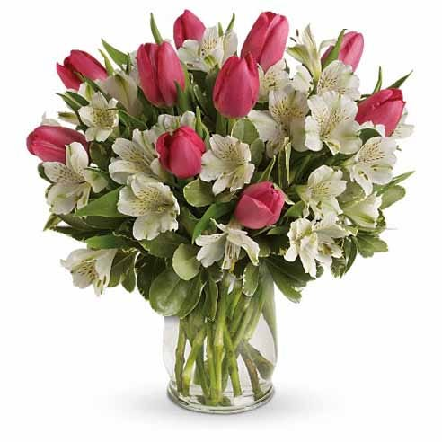 Pink tulips and white alstroemeria flower bouquet with variegated pittosporum