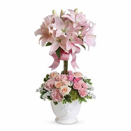 Topiary flower arrangement with pale pink lilies and carnations in white pot