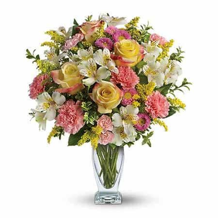 Pastel yellow rose bouquet with pink carnations, white alstroemeria and Easter flowers